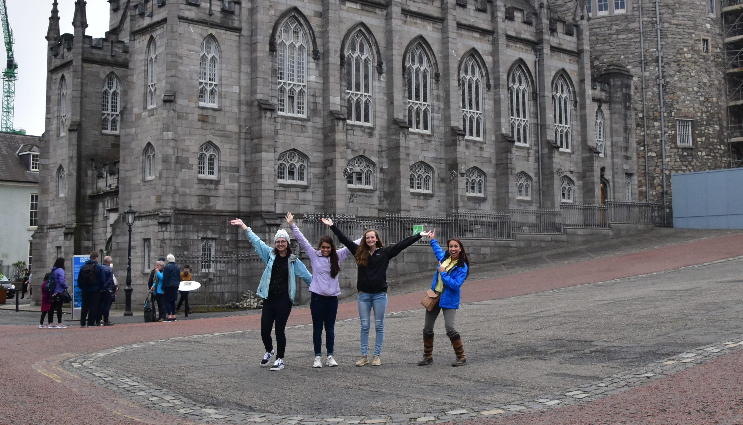 students posing in front of a building